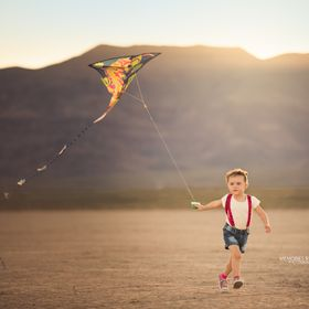She is such a free spirit child and I love it, first time flying a kite.