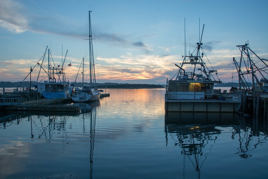 This photo was taken in Yarmouth Nova Scotia Canada as the sun was setting in the harbour.