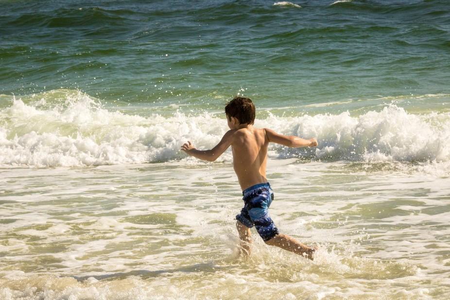 Surf beckoning boy in Pensacola