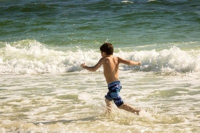 Boy racing into surf