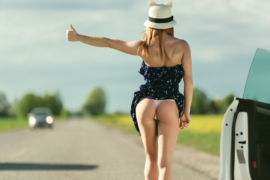 Young beautiful model pose on the road
