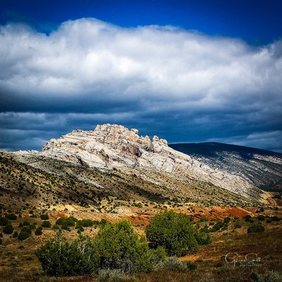 Split Mountain, DNP, Utah-Colorado. The clouds finally broke and the sun beamed diwn to light up all the brilliant desert colors.