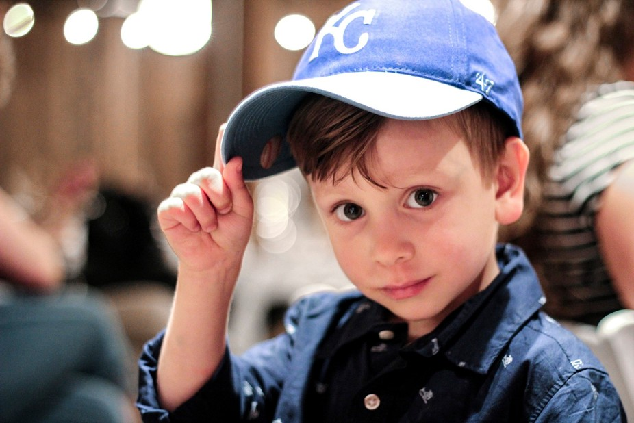 My son at a wedding with his present, the hat, from his aunt and just recent uncle for being the ...