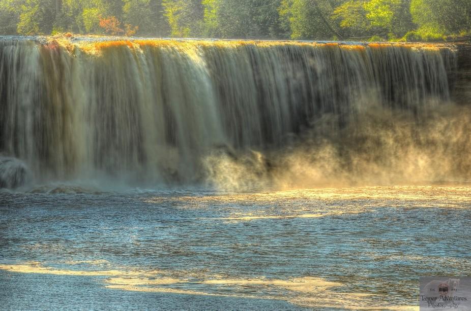 upper Tahquamenon falls U-P Michigan. During late spring runoff the river drains as much as 50,00...