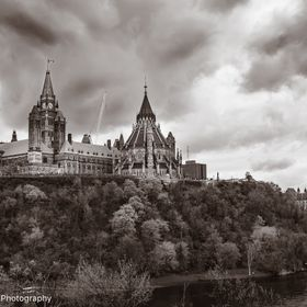 The Parliament of Canada. This view of Parliament is from the Major's Park Hill. As dark clouds of May gather over the House of Commons, it sta...