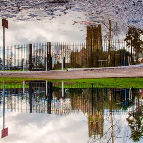 Puddle that forms after every shower in Hedon providing a great reflection of the nearby church when conditions are perfect.
