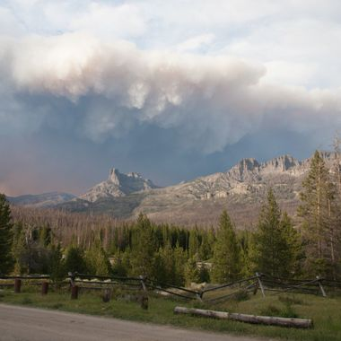 The smoke from a wildfire in Wyoming created an ominous cloud formation over the mountains near the Double Cabin Campground north of Dubois, Wyoming.