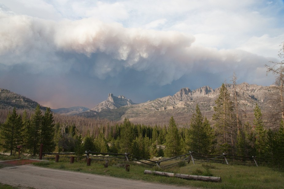 The smoke from a wildfire in Wyoming created an ominous cloud formation over the mountains near t...