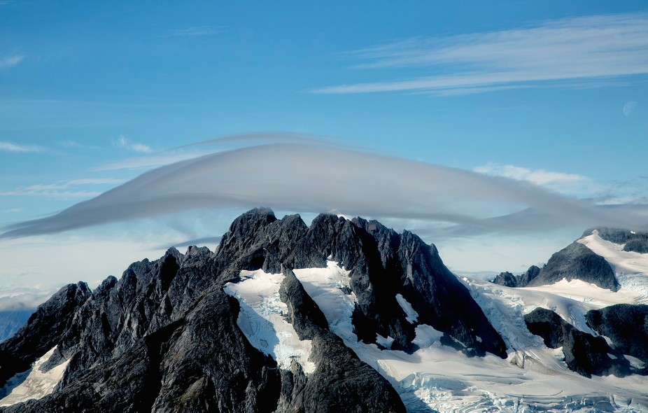 Captured these wisps of Clouds Above the Mountains of Glacier Bay National Park, Alaska from an a...