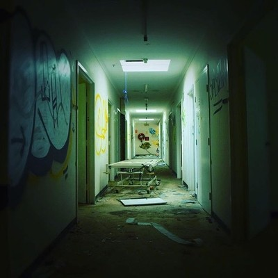 This hallway in an abandoned rest home REALLY gave me the creeps; esp when I noticed the noose!!