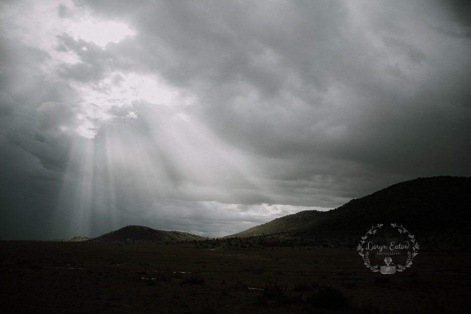 Sun rays during a rain storm in Africa
