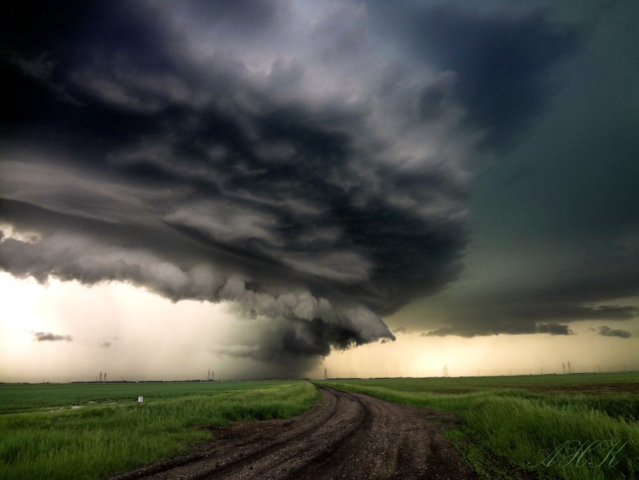 A summer shelf cloud sweeping across the prairies.
