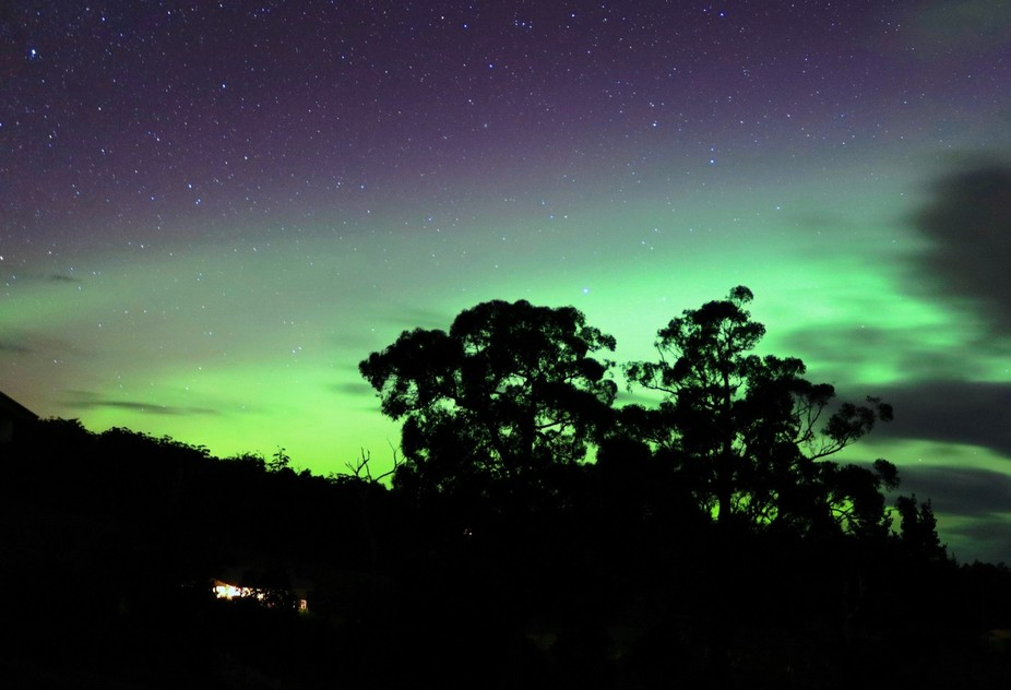 A blue green proton arc comes in from the west over the top of the auroa australis at Abels Bay, ...