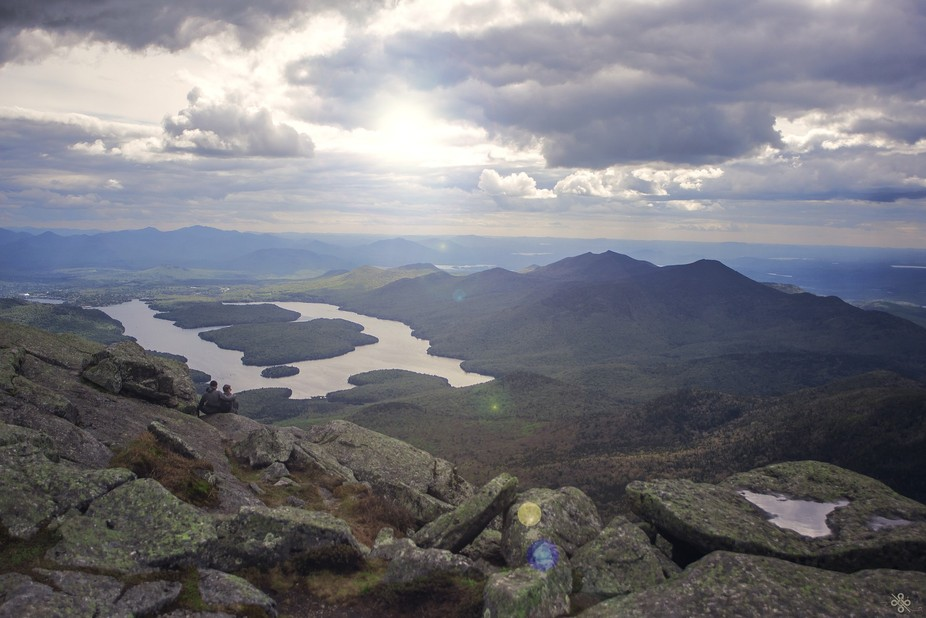 I saw this couple sitting on the edge of the cliff on Mount Whiteface looking over Lake Placid.  ...