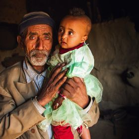 A man holds his granddaughter as the family celebrates her first birthday. I took this image in a remote area in the highlands of Ethiopia.