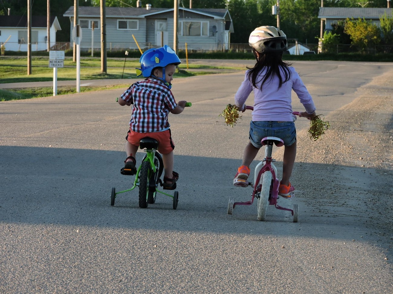 two little human beings enjoying a bicycle ride