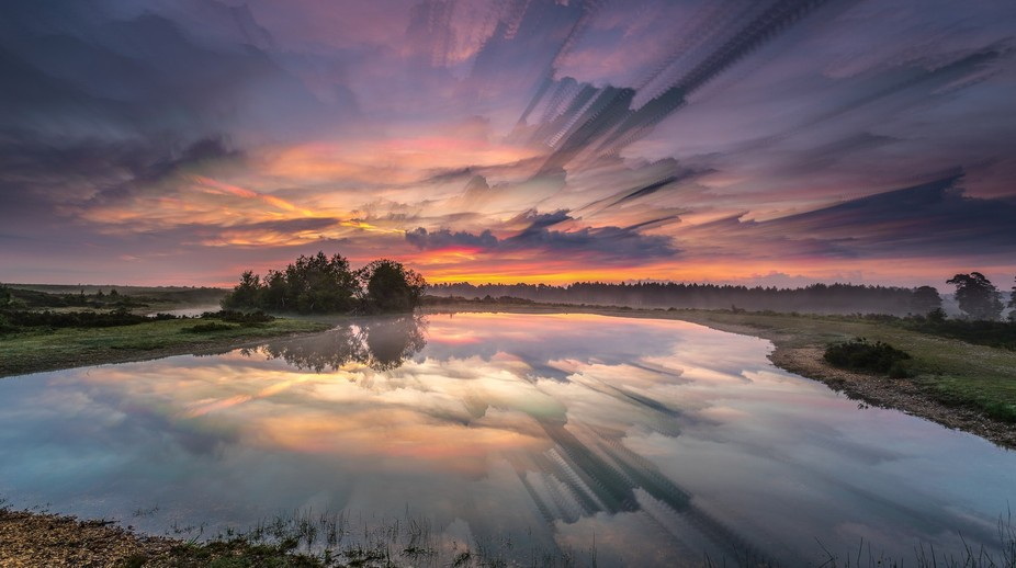 Slufters Pond in The New Forest. A cloud trail image taken over an eight minute period.