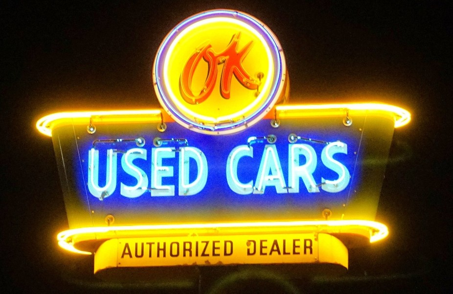 Part of a local neon restoration project, this sign sits outside a vintage automobile sales busin...