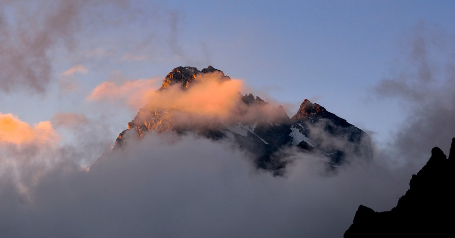 After a misty night dawn is there. For a short moment Monviso reveales itself before it hides beh...
