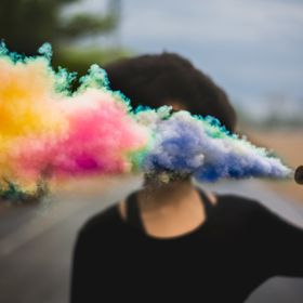 Chicago-based model, Funlola poses with a colorful smoke bomb.