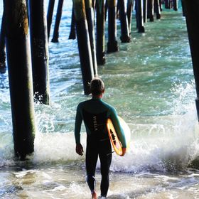 A surfer preparing to dive into the San Clemente ocean.