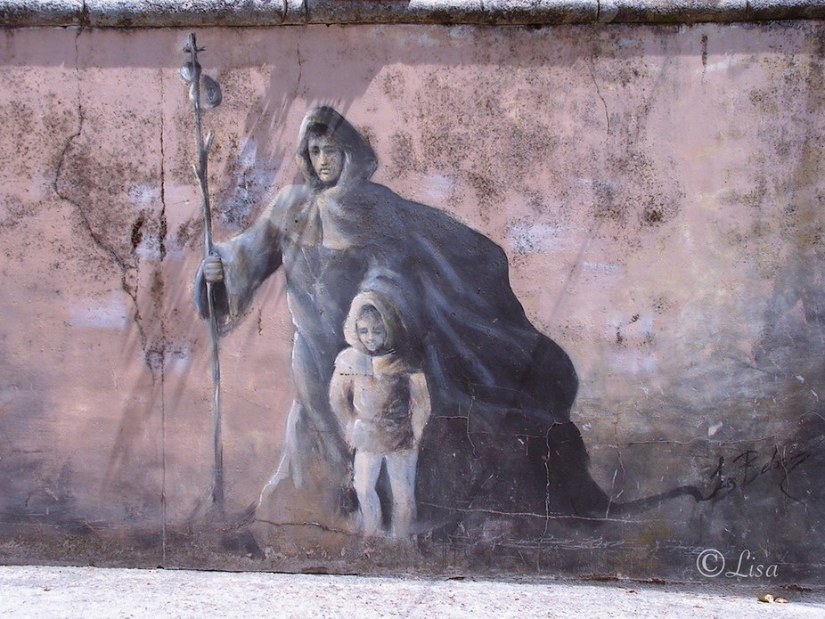 All along a wall, in Spain, those paintings... of pilgrims.