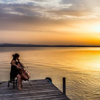 After a day at the beach with the family, we drove down to Parque Natural de la Albufera de Valencia and caught this celloist setup on the end of the pier under this insane sunset! What a magical moment both visually and to my ears!