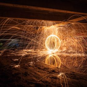 Steel wool orb under a bridge