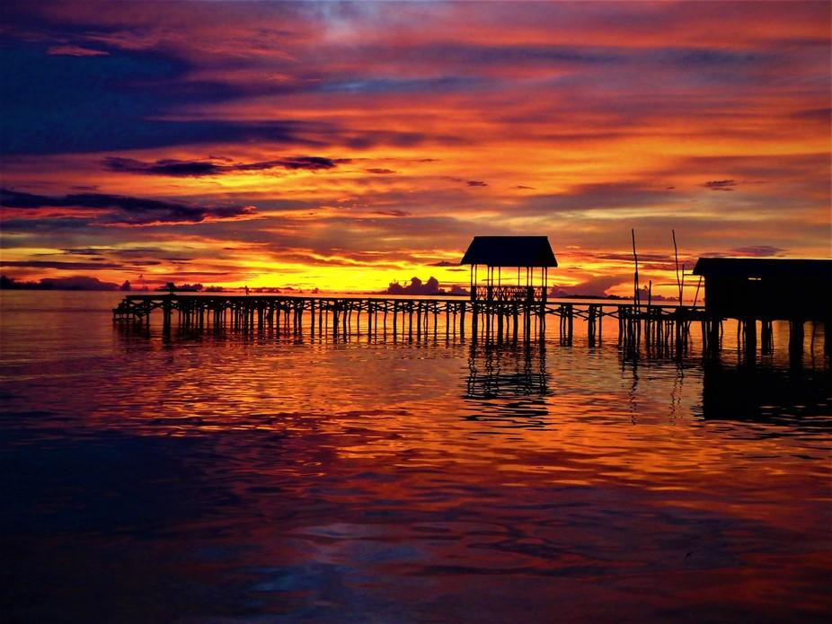 This was taken in Raja Ampat near the island village called Arborek.  Best sunset I have seen in ...