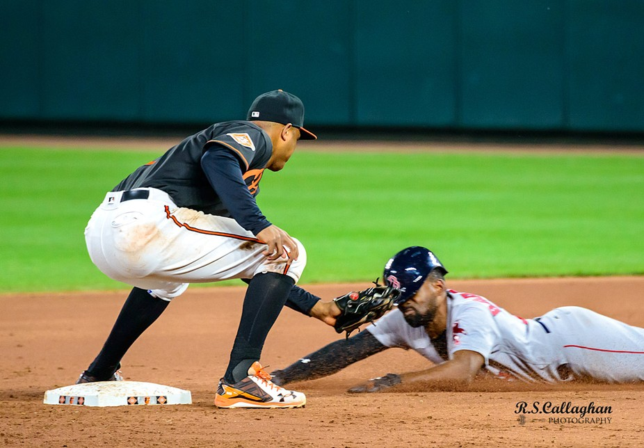 Red Sox outfielder Jackie Bradley, Jr. is tagged out by Jonathan Schoop, Orioles second baseman, at Camden Yards, Baltimore, June 2, 2017.