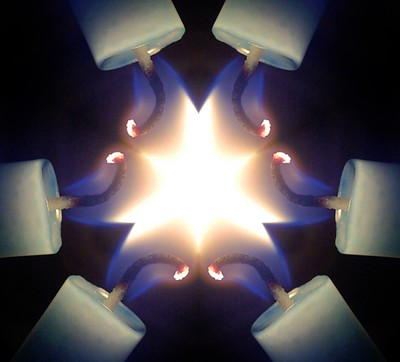 """The flame of a candle photographed in the mode """"kaleidoscope"""""""