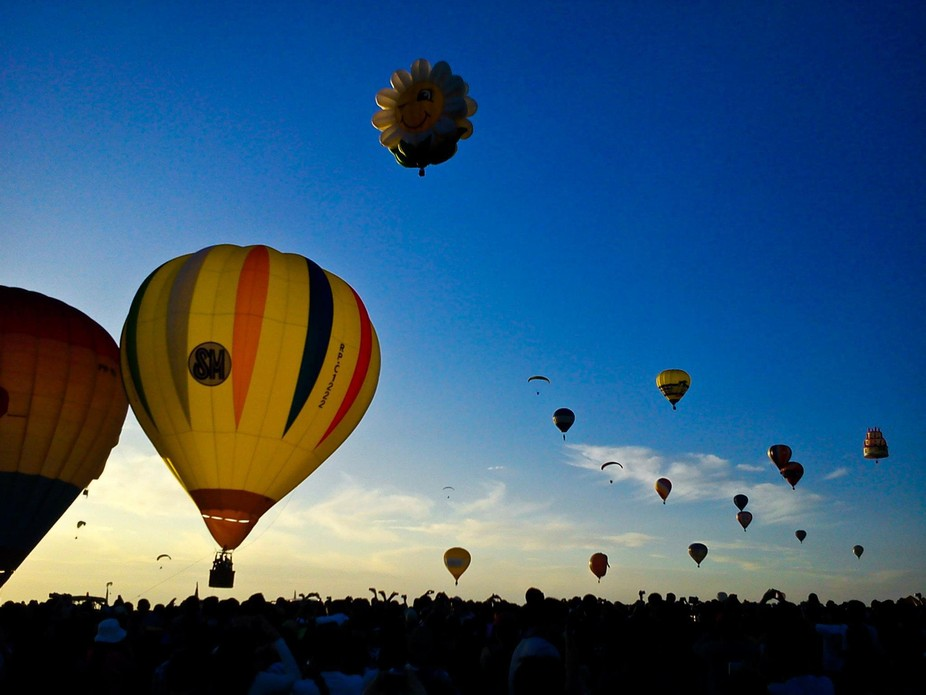 As the day breaks, hot air balloons are released into the sky.