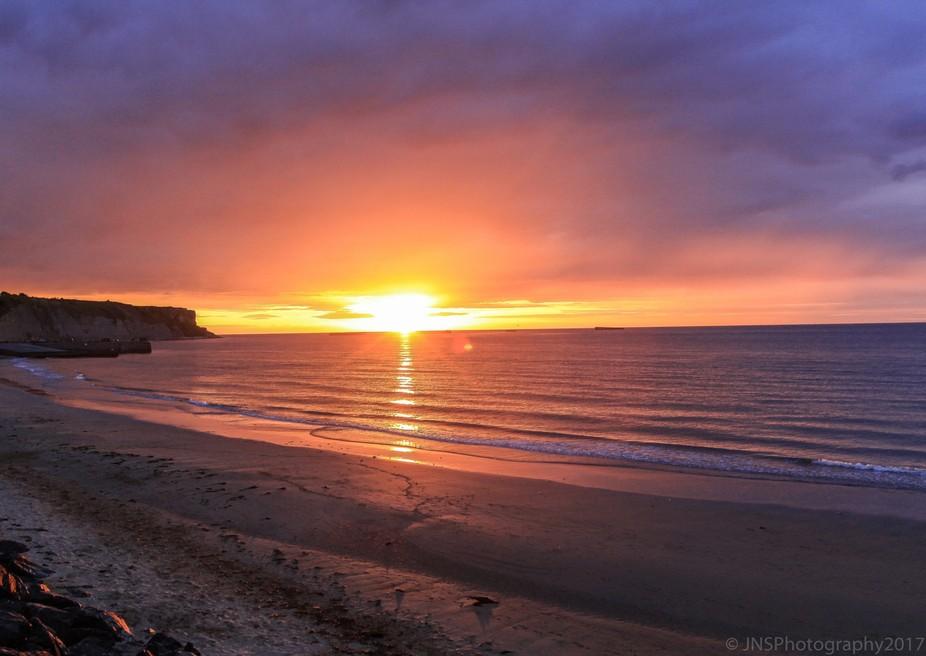 sunset over gold beach
