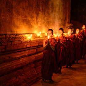 Five novice monks are focused for one brief moment. They were young boys, having fun, laughing, poking and pushing each other. The senior monk ha...