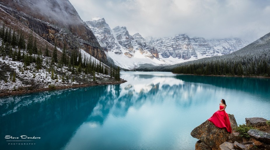 Noriko rocks her red dress at the stunning Moraine Lake, near Banff National Park in Canada.