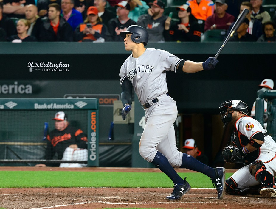 Perfectly balanced, Aaron Judge, New York Yankees outfielder starts his run to second base after smashing the ball against the wall in Camden Yards, Baltimore.