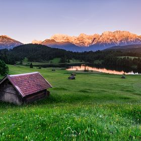 It was a long hiking day visiting 3 lakes in Southern Bavaria. At the last lake in our tour we were rewarded by spectacular sunset in this idylli...