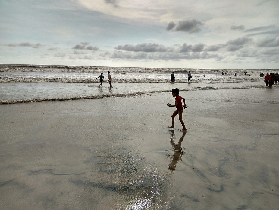He was going in the sea when his father screams his name. Captured in June 2017 Mumbai,India