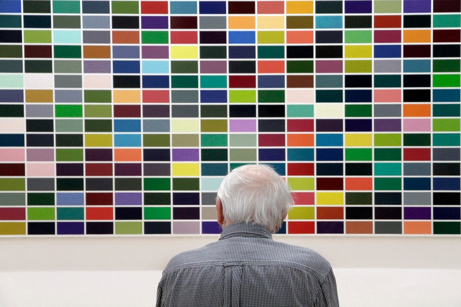 The elderly man and picture of the modern art in the Centre Georges Pompidou in Paris.