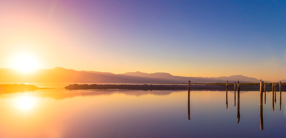 Sunset on the lonely shores of the Salton Sea in California.