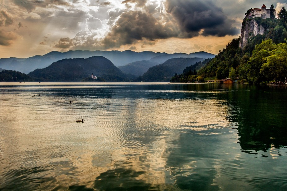 Beautiful Lake Bled in Slovenia at sunset on a stormy day.