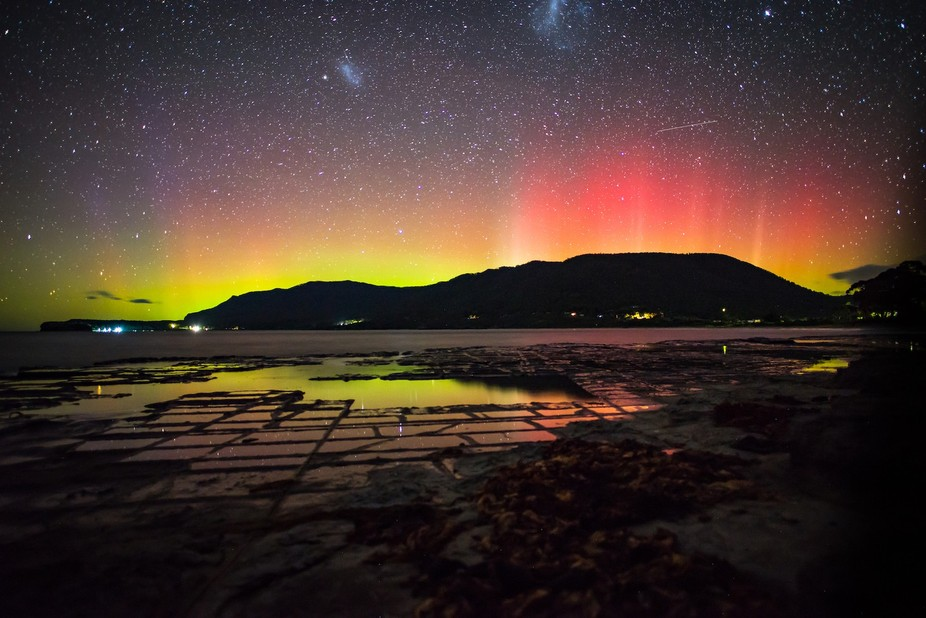 The Southern lights of the Aurora Australis reflected in the pans of the Eaglehawke Neck, Tasmania