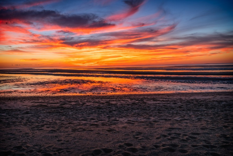 A colorful sunset on Cooks Brook Beach on Cape Cod.