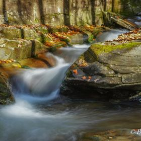 Beautiful formation of rocks and water with Autumn color at Frost Valley, New York State, USA.
