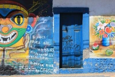 Door in Graffiti Covered Wall