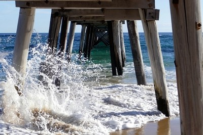 View under the pier at Port Noarlunga .
