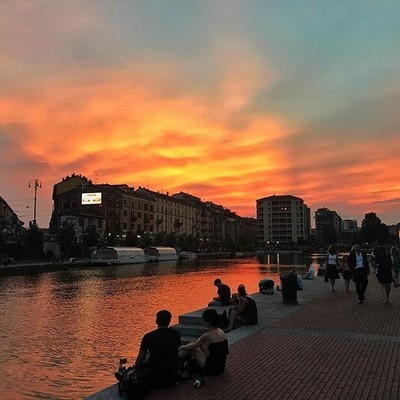 A picture I took while I was out in #milan the sky looks unnatural. . . . #city #summertime #goodvibes #iphone #photography #photo #photooftheday #travelphotography #paradise #color. #colours #italy #river #bdteam #light #lighting #red #yellow