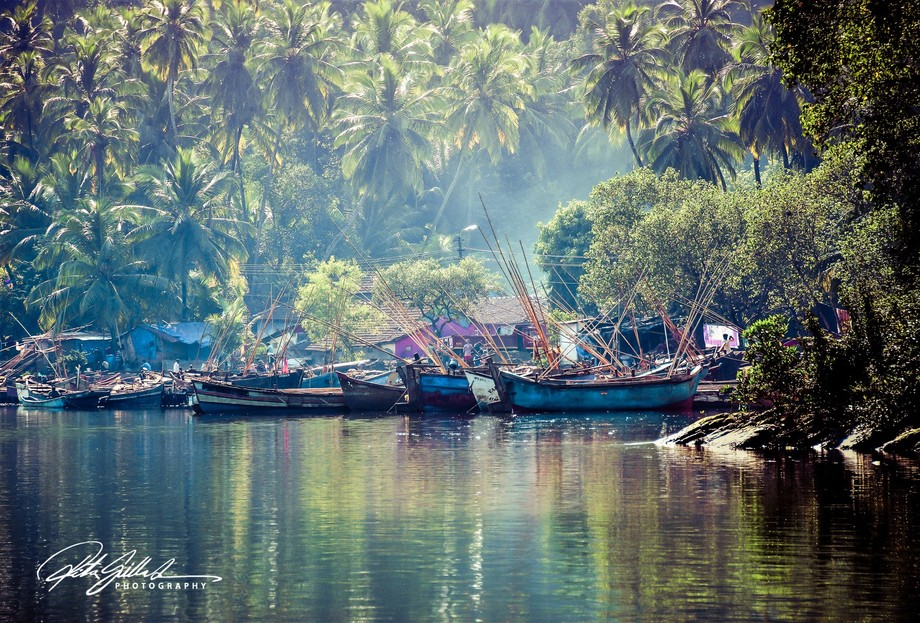 fishing boats on Chapora river in India in morning haze