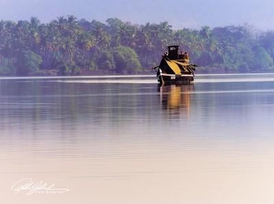Boat in morning haze