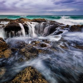 Located at Cape Perpetua Thor's Well is a bowl-shaped hole that is the result of a collapsed sea cave. At high tide, the bowl fills up and s...